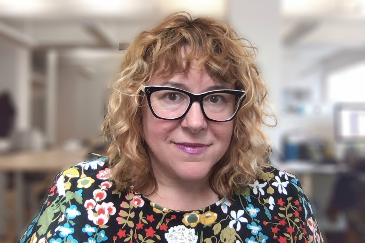 Photo of heather spratt, woman with glasses and blonde curly hair